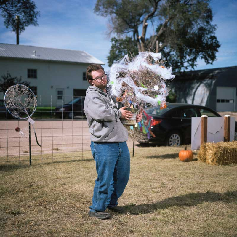 Boy holding decorated halloween tumbleweed