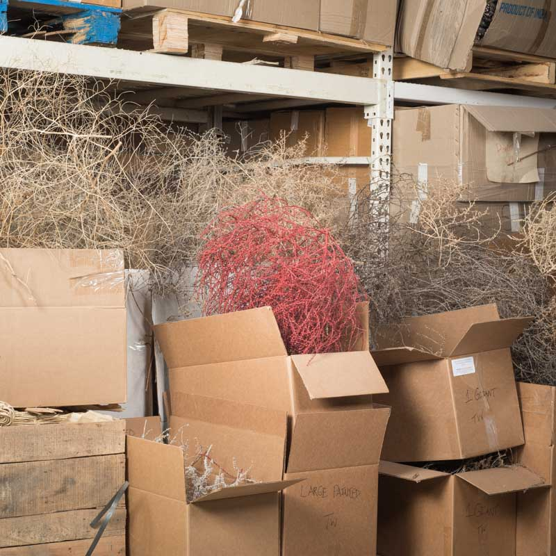 Red painted tumbleweed in warehouse